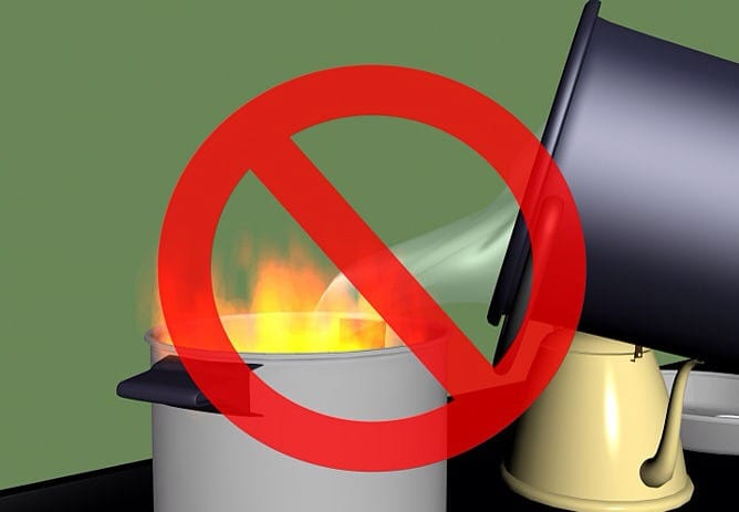 Do not use water, flour, baking powder, sugar, or a wet towel to put out a grease fire